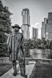Austin, Stevie Vaughan statue, BW, black and white, bronze, Independent, Jingle, high rise, skyscraper, Lady Bird Lake, Butler hike and bike trail, blues, guitar, rock and roll hall of fame, music