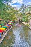 River Walk, SA, San Antonio, blue sky, boat, colorful umbrellas, couds, toursit, white puffy clouds