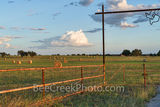 Haybales, haybales, Texas Hill Country, landscape, grasses, round bales, feed, horses, cows, goats, sheep, sunset, clouds, evening, farmer, field, llano, Texas, gate