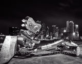 Dallas, traveling man, sitting sculpture, banjo, robo, skyline, skylines, cityscape, cityscapes, downtown,  modern, urban, night, robot, deep ellum, mass trasit, train, nuts, bolts
