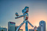 Dallas, traveling man, skyline, train, rail road, mass transit, scuplture, robot, strolling, bird, birds, Deep Ellum, cityscape, cityscapes, day, images of dallas, photos of dallas, pictures of dallas