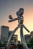 Dallas, traveling man, sunset, vertical, skyline, train, mass transit, scuplture, robot, stainless steel, rivets, guitar, music, strolling, Deep Ellum, cityscape, cityscapes, images of dallas, photos