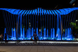 Houston, George Brown convention center, Wings Over Water, blue phase,  kinetic, sculpture, downtown, street scene, lifestyles, city life, urban, art, water feature, horizontal, people, night