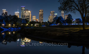 Houston skyline, cityscape, hike and bike trail, Police Memorial, dark, downtown, city, Buffalo Bayou, reflection, moon lights, faint blue glow, trees, tallest buildings, southwestern, US, Texas, pano