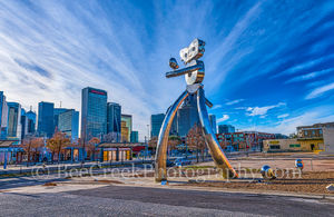 Dallas, Deep Ellum, bird, birds, cityscape, cityscapes, day, images of dallas, mass transit, photos of Dallas, pictures of Dallas, robot, scuplture, skyline, strolling, train, traveling man, us, usa
