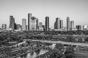 Houston Skyiine at Dusk - This is an aerial shot of the Buffalo Bayou and city park from a different area with the Houston Skyline in the background in black and white as the sun was setting. You can