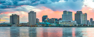New Orleans, cityscape, cityscapes, colorful sky, dark clouds, orange, pinks, reflections, skyline, skylines, sunset, water, waterfront, yellow, New Orleans cityscapes,