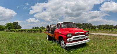 Hill country winery, bright red truck, wine, barrels, grapes, grape vines, pano, panorama, clouds, blue sky, texas hill country, 1851, truck,