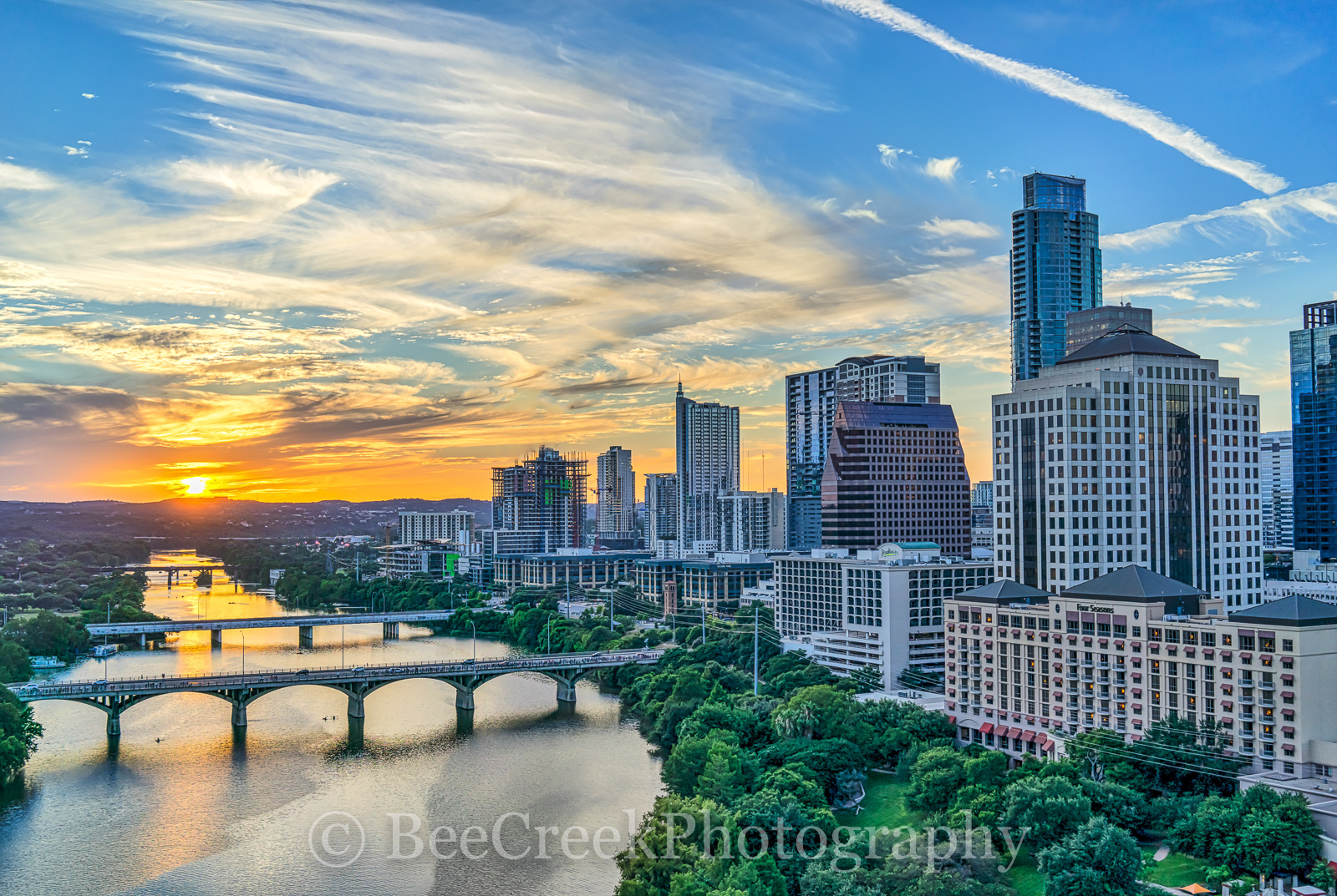 Austin Sunset Skyline Above, aerial, over austin, Austonian, Congress bridge, First Street Bridge, Four Seasons hotel, Lamar bridge, Radison hotel along the shoreline, aerial, cityscape, downtown, sky, photo