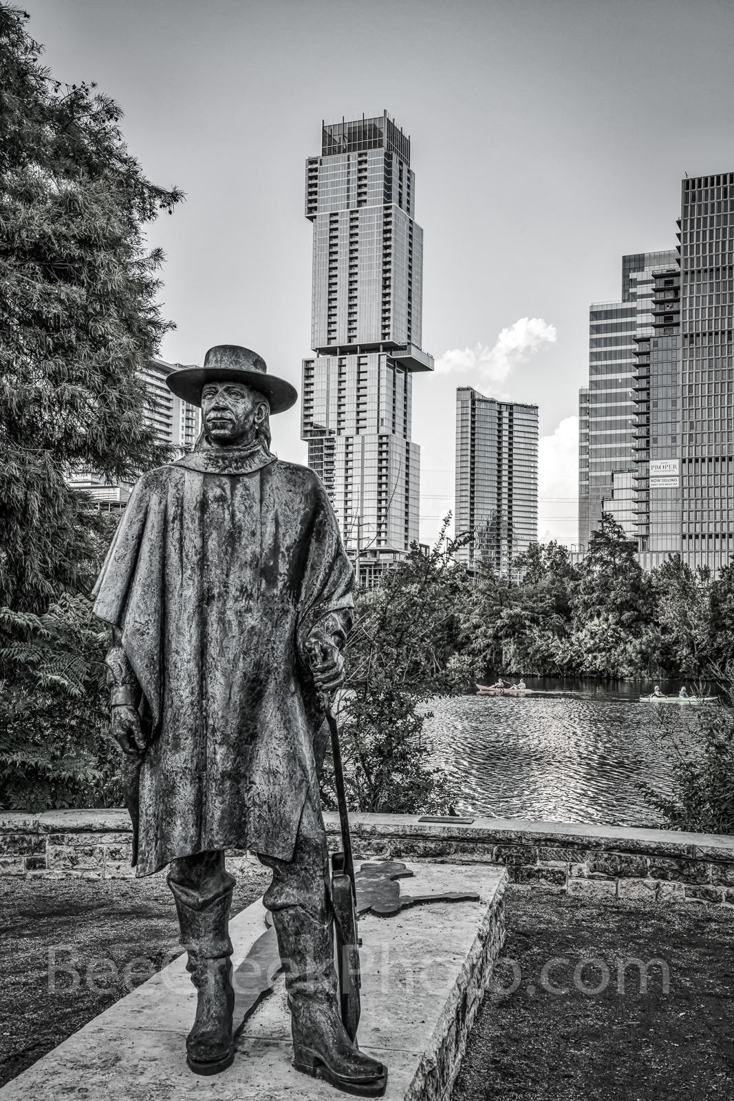Austin, Stevie Vaughan statue, BW, black and white, bronze, Independent, Jingle, high rise, skyscraper, Lady Bird Lake, Butler hike and bike trail, blues, guitar, rock and roll hall of fame, music,, photo