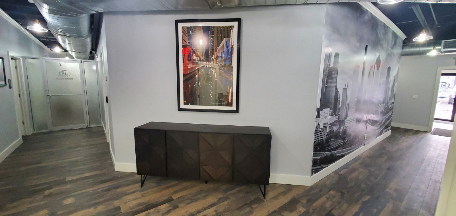 """A 30""""x45"""" fine art print of the Houston mass transit rail train as it passed by framed and installed at our client's office in..."""