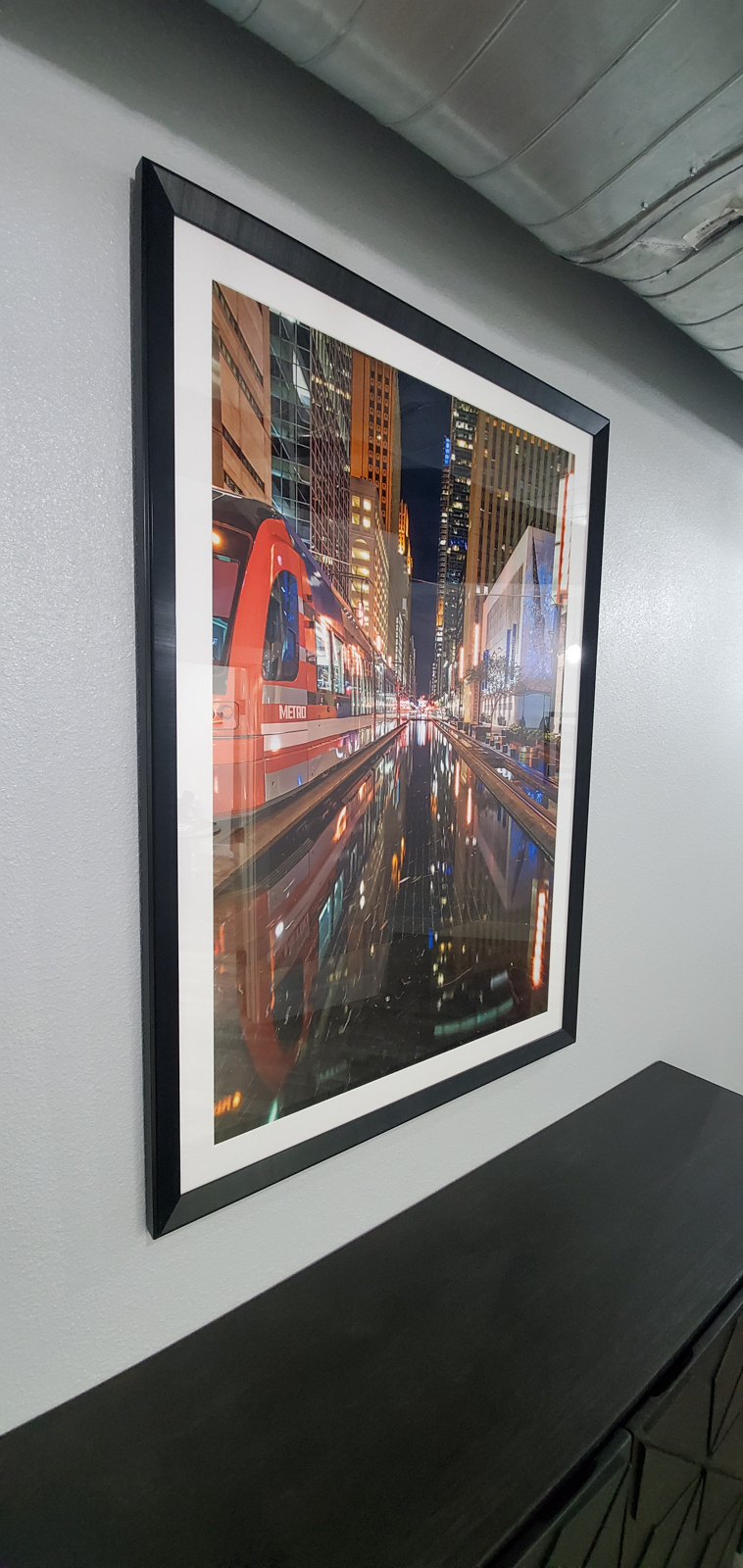"Another client provided image of the A 30""x45"" fine art print of the Houston mass transit rail train as it passed by framed and..."