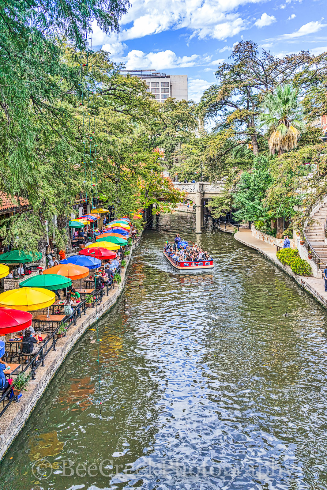 River Walk, SA, San Antonio, blue sky, boat, colorful umbrellas, couds, toursit, white puffy clouds, photo