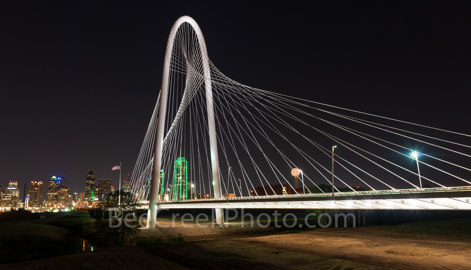 Margaret Hunt Hill Bridge in Dallas Texas at night. This is a two to one capture of the Dallas skyline with the Margaret Hunt...