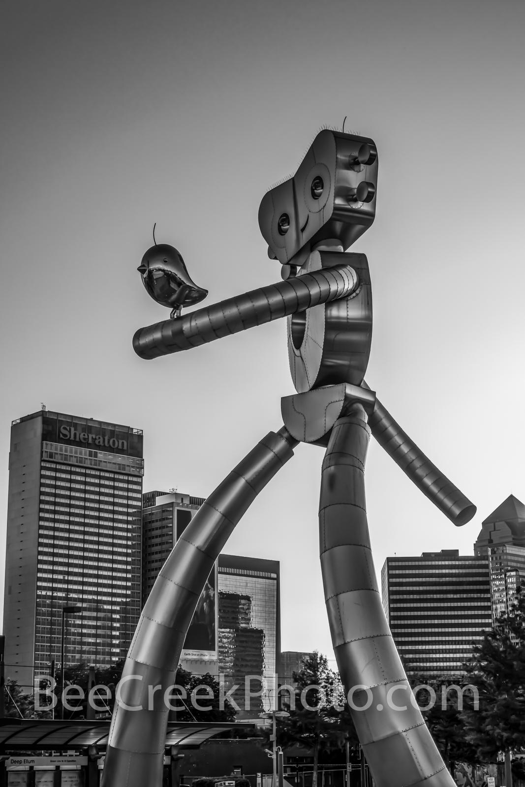 Dallas, traveling man, vertical,  dallas skyline,  Deep Ellum, mass transit, scuplture, robot, stainless steel, rivets, guitar, music, strolling, pictures of dallas,  Dallas skyline,  east dallas, dus, photo