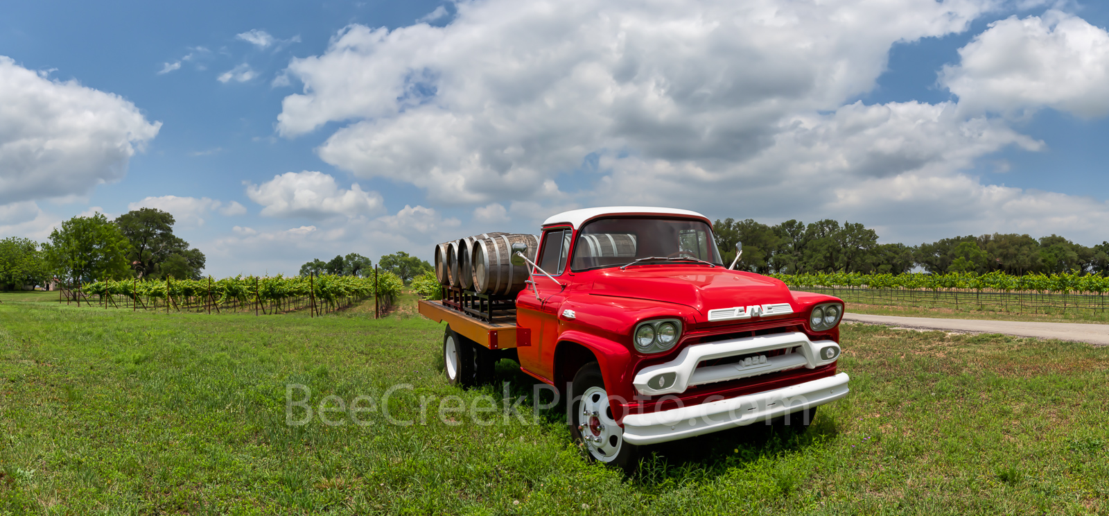Hill country winery, bright red truck, wine, barrels, grapes, grape vines, pano, panorama, clouds, blue sky, texas hill country, 1851, truck,, photo