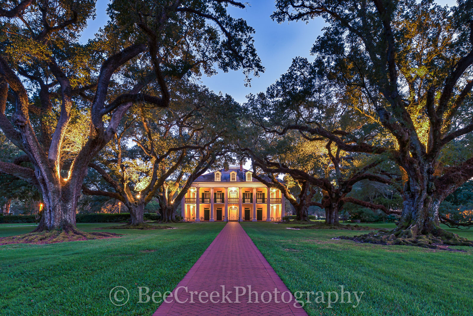 Lousiana, National Historic Landmark, Oak Alley, architect, archtiectural, big house, branches, dusk, glow, golden, greek rivival, landscape, landscapes, lights, mansion, mississippi, night, oak trees, photo