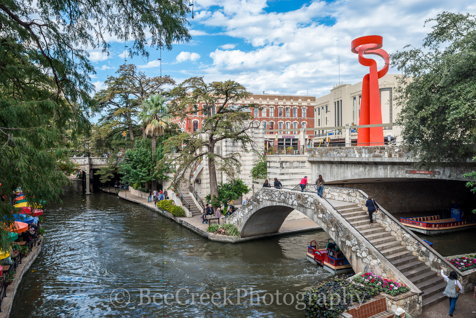 Riverwalk, San Antonio, Torch of Friendship, city, cityscape, cityscapes, clouds, colorful, colorful umbrellas, downtown, river boats, tourist, water, photo