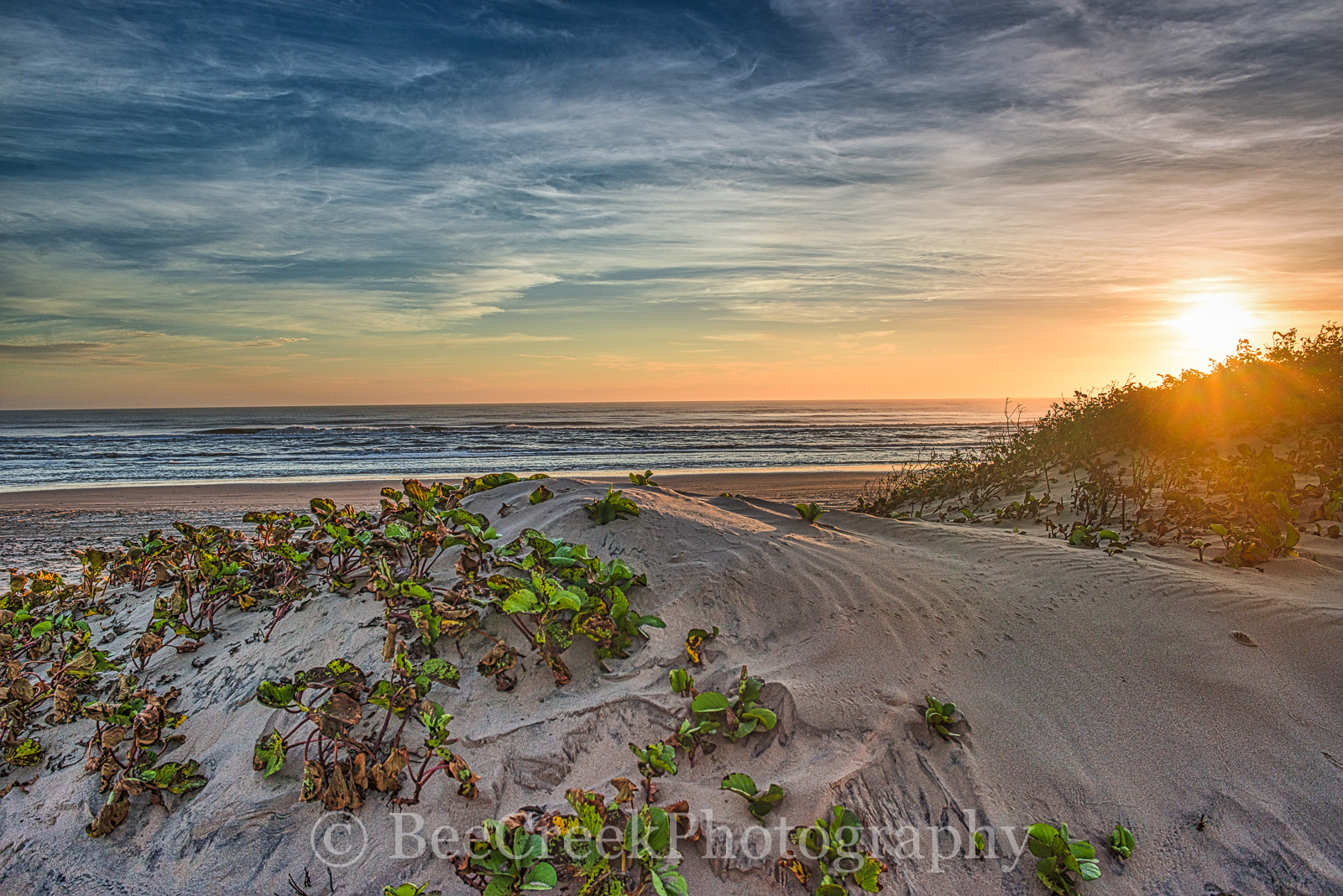 Sand Dunes at Sunrise -  Took this sunrise photo of a beach scene as the sun cast a bit of color along the the horizon over Padre...