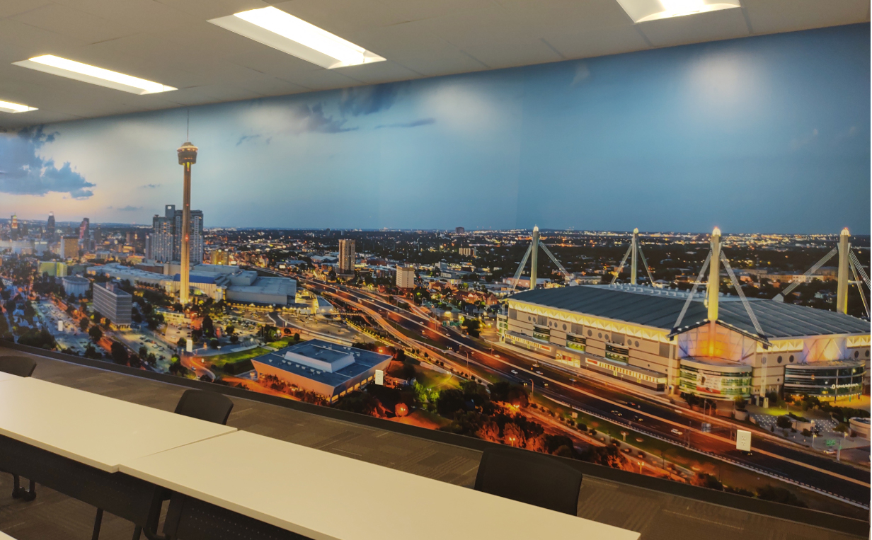 Skyline of San Antonio Texas 32'x8' wall mural installed in a conference room at a clients office in San Antonio Texas.  The...