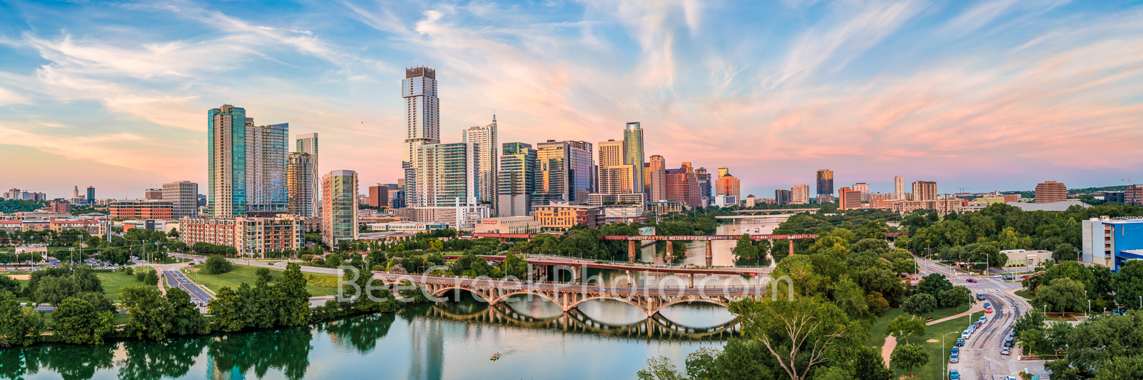 Austin skyline, aerial, drone, sunset, pics of texas, pics of austin, lamar bridge, first st. bridge, lady bird lake, clouds, pink, orange, sky, clouds, hike and bike trail, colorado river, architectu