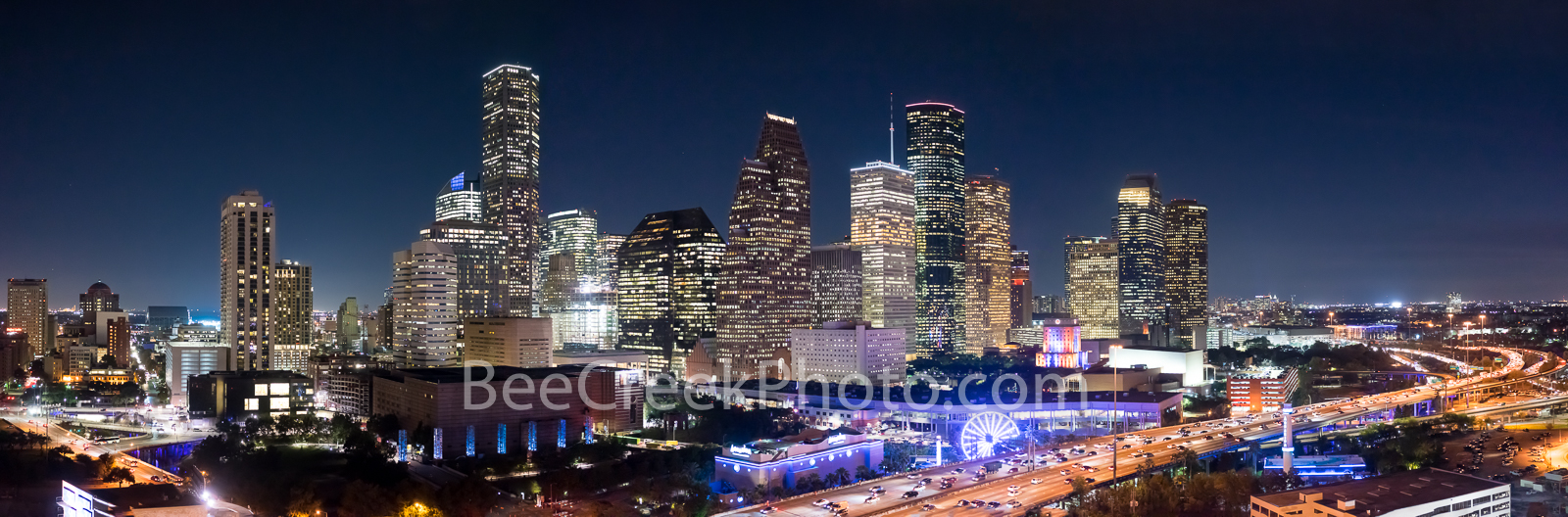 Aerial Houston Skyline Night Pano - Aerial Houston Skyline pano night along IH45 in downtown area of the city. This image show...