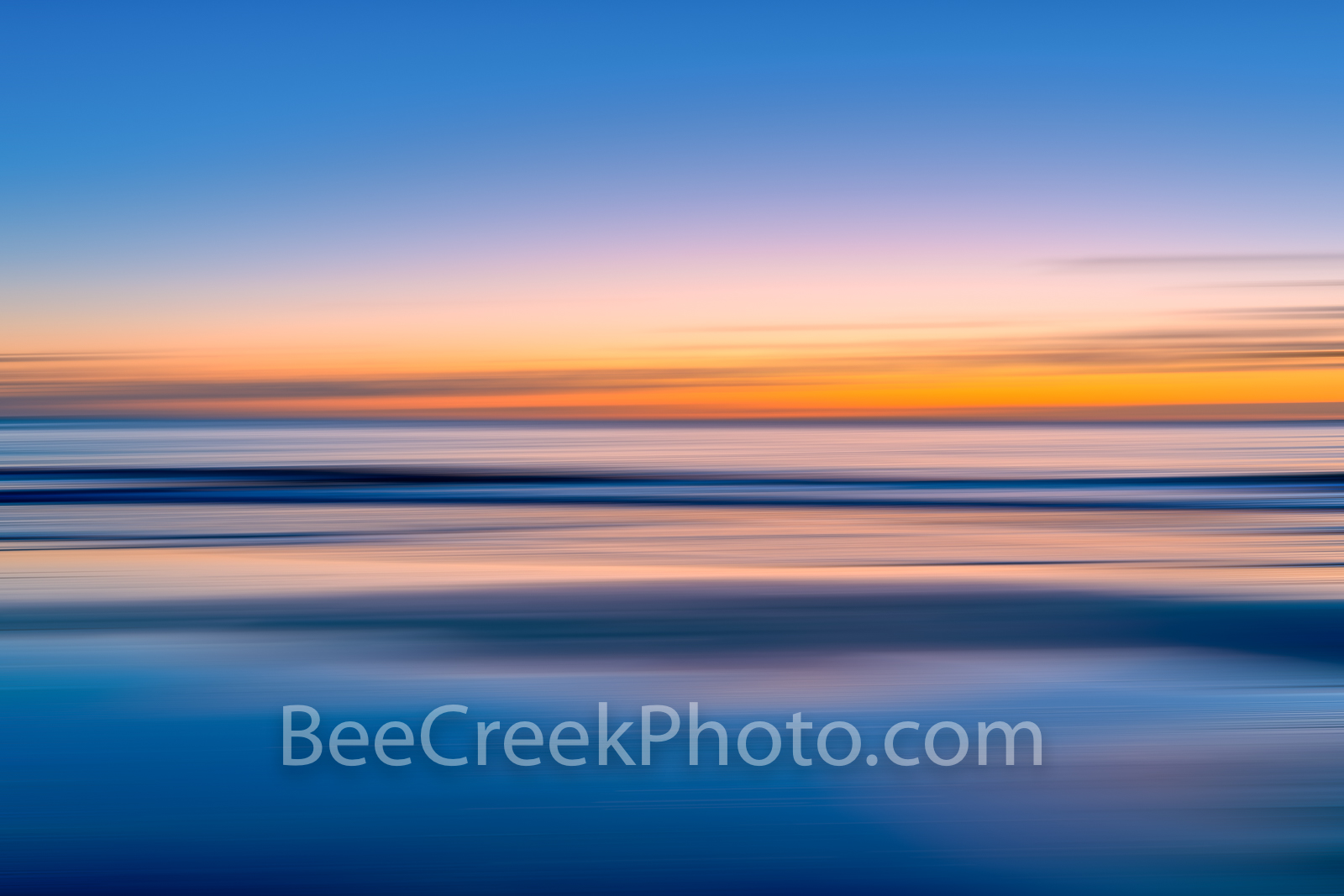 Alantic Ocean Vivid Sunrise - This abstract of vivid hues of blues, pinks, orange and yellow over the ocean waves with this long...