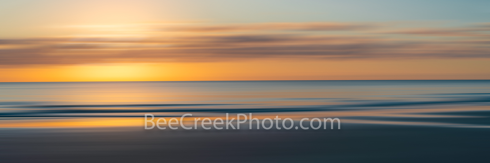 Atlantic Serenity Sunrise Pano - A stunning abstract over the Atlantic ocean at sunrise as the sky light up with a magical golden...