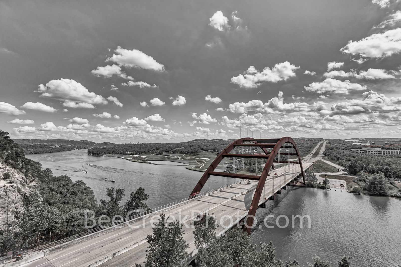 Austin 360 Bridge BW Pop of Red -  Austin Pennybacker Bridge with a beautiful cloudy sky and a little selective coloring bringing...