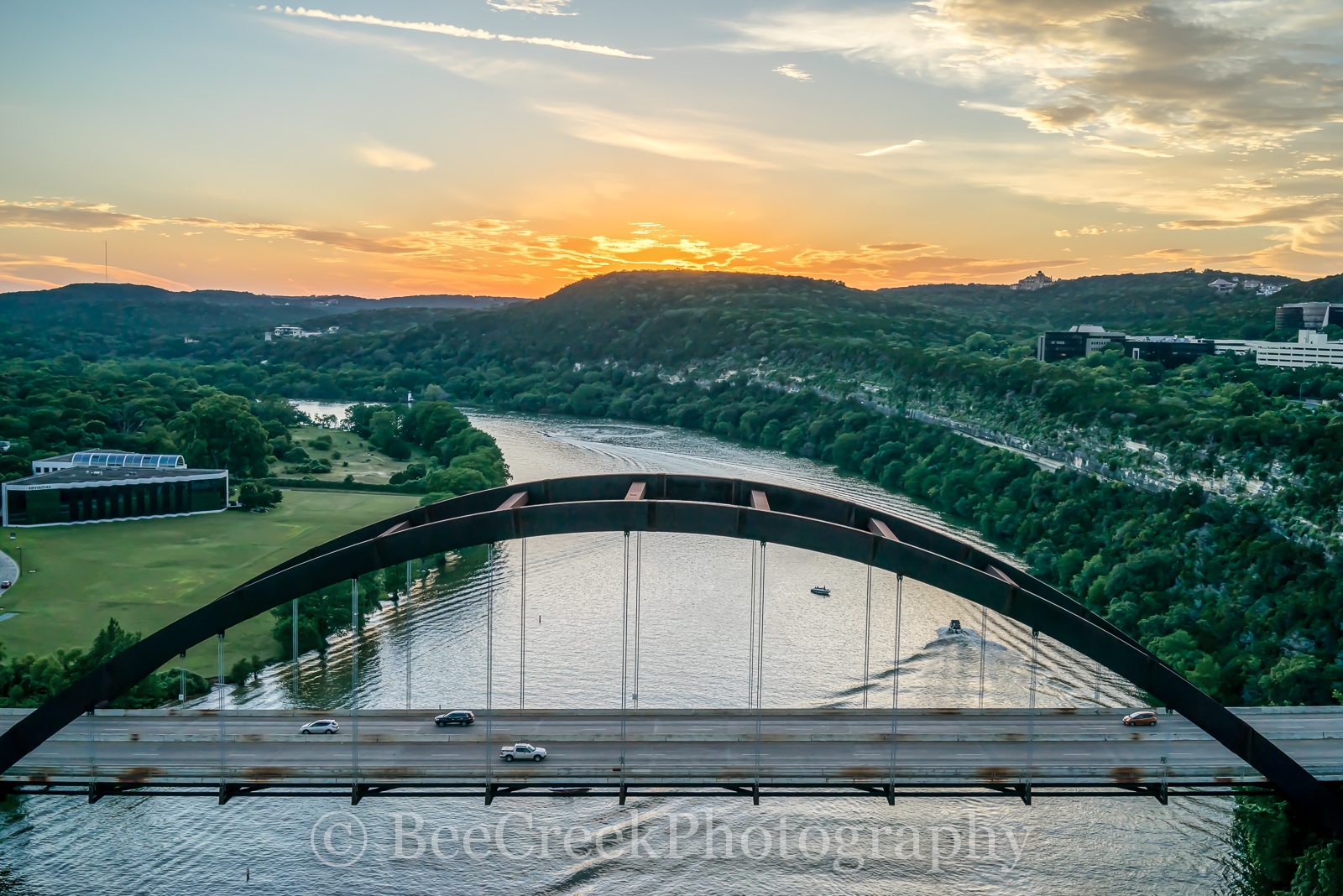 Austin 360 Bridge Sunset -  This is an aerial image of the Austin 360 bridge or Pennybacker bridge at sunset taken from above...