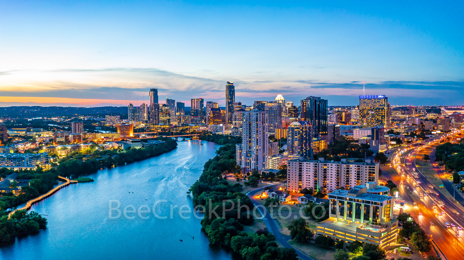 Austin Aerial Skyline Twilight View, Austin skyline, aerial, drone, Austin, night, twilight, dark, Lady Bird Lake, high rise buildings, architecture, boardwalk lights, shoreline, lake, IH35, UT, Erwin
