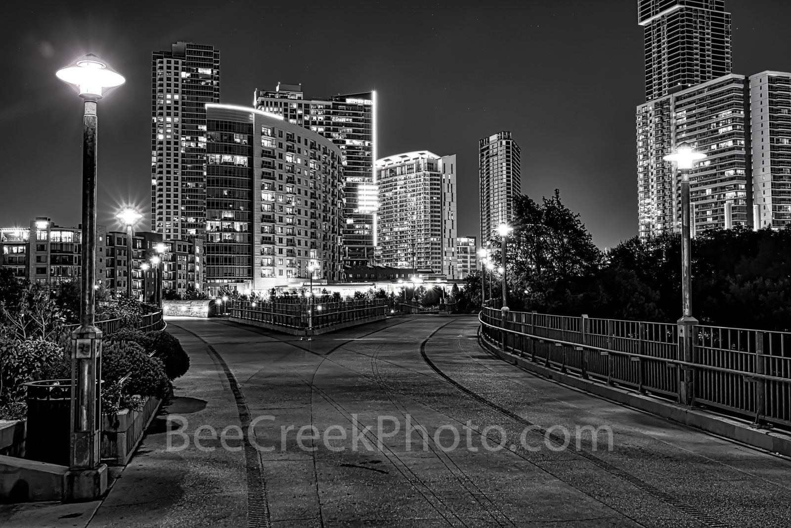 Austin Pfluger Bridge at Night BW - Austin Pfluger Bridge at Night BW or in black and white on Ladybird Lake with the high-rise...