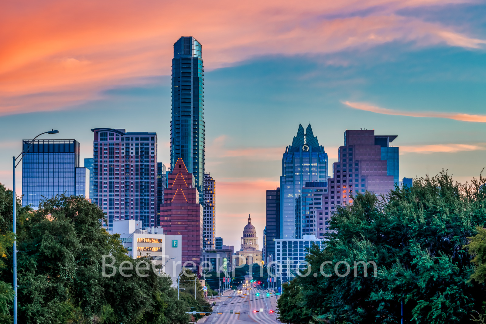 Austin Skyline and Texas Capitol with Colorful Sunrise - A view looking up Congress toward the Texas Capitol with the downtown...