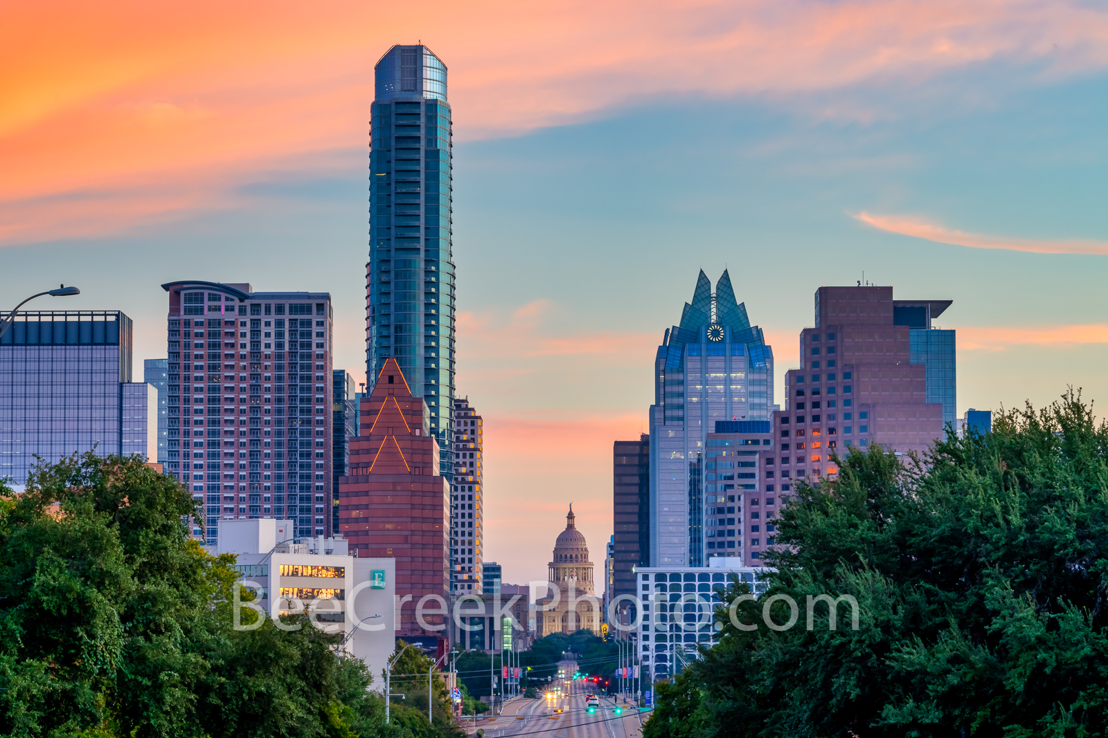 Austin Skyline and Texas Capitol Sunrise 2 - A tighter view looking up Congress toward the Texas Capitol with the downtown Austin...