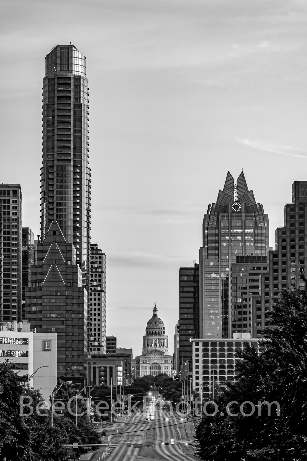 Austin Skyline and Texas Capitol Sunrise Vertical BW - A view looking up Congress toward the Texas Capitol with the downtown...