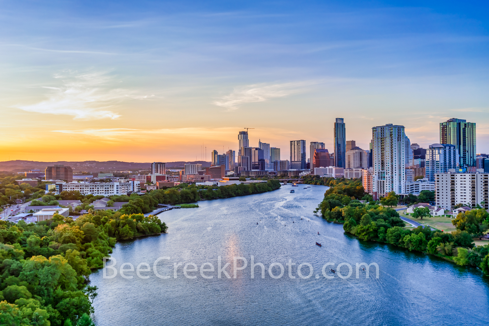 Austin skyline, austin skyline aerial, austin skyline pictures, austin skyline images, images of austin skyline, aerial, drone, austin, night, twilight, dark, lady bird lake, high rise buildings, arch, photo
