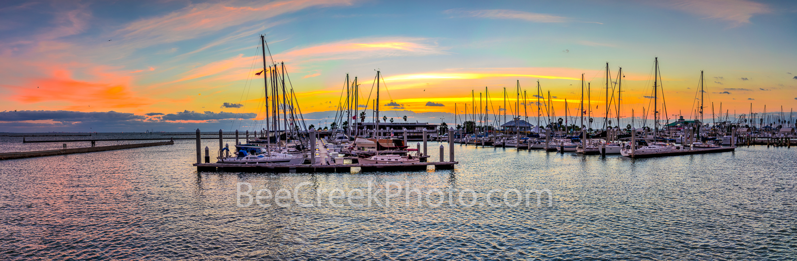 Corpus Christi Marina Sunrise Pano  -  Corpus Christi at sunrise over a marina with the colorful sky in the background...