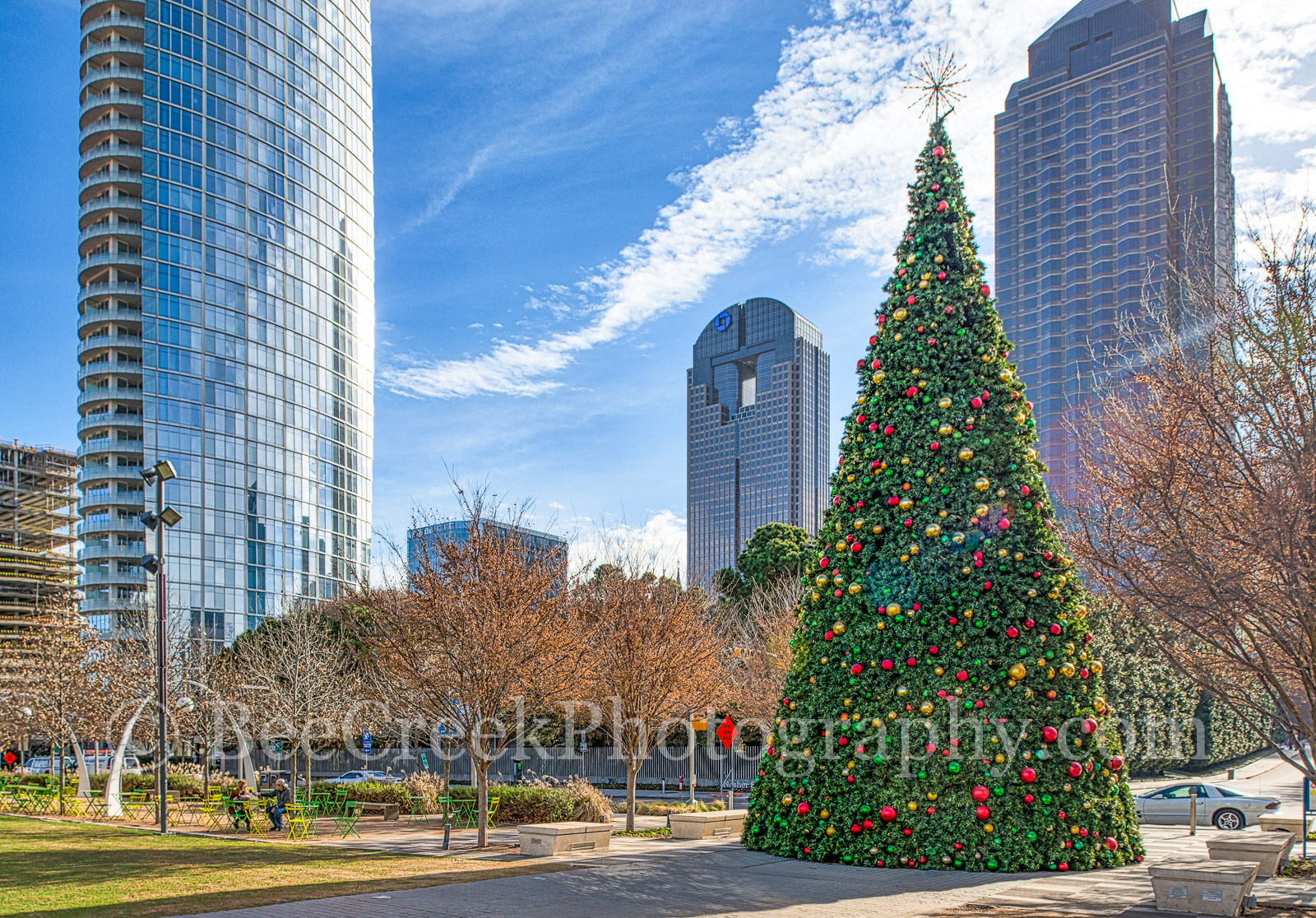 Dallas Christmas Tree with Skyline-The Christmas tree at the Klyde Warren park with the Dallas skyline in the background...