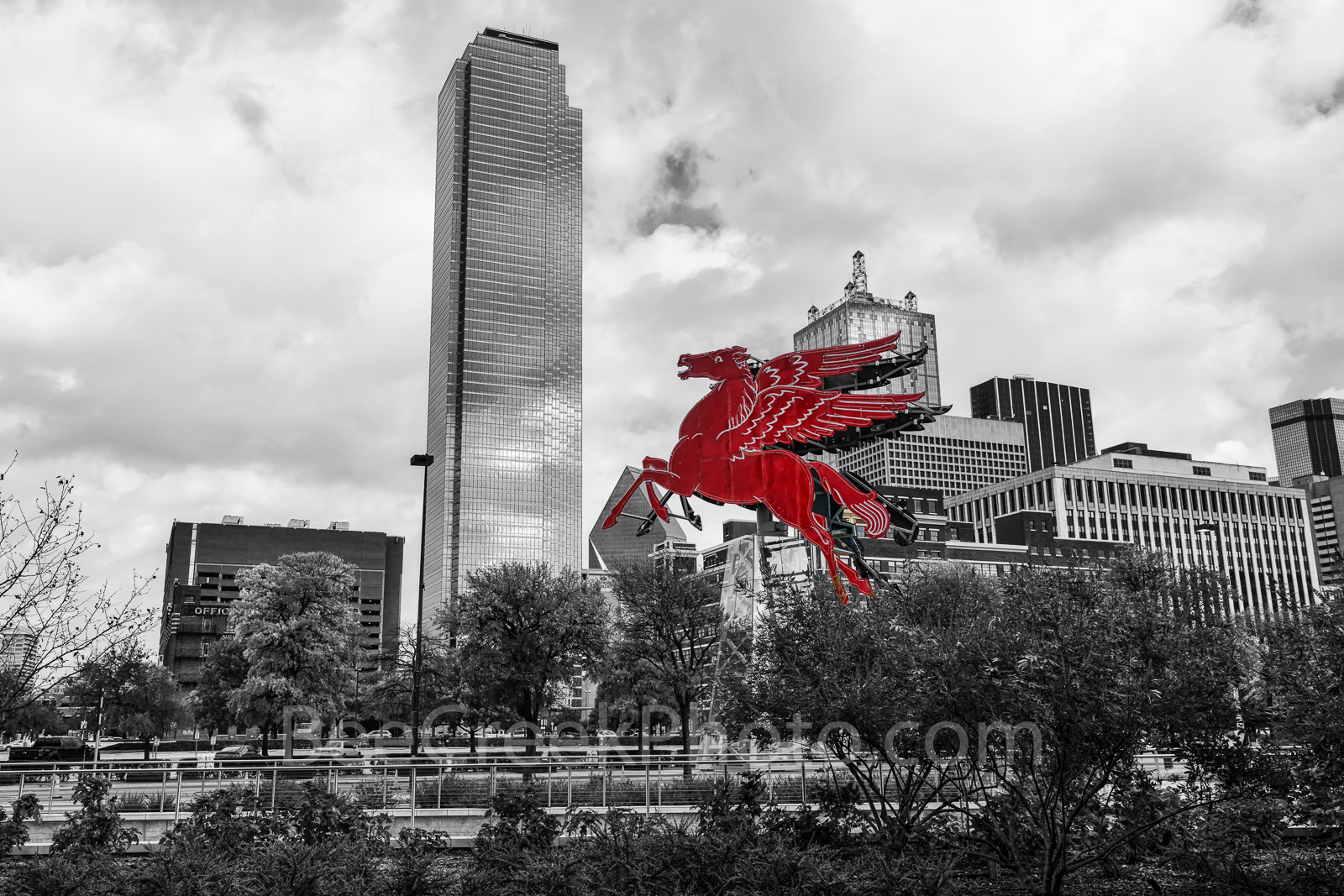 Dallas Downtown BW Red Pegasus - We capture this image with the Dallas downtown skyline in black and white with only the Pegasus...