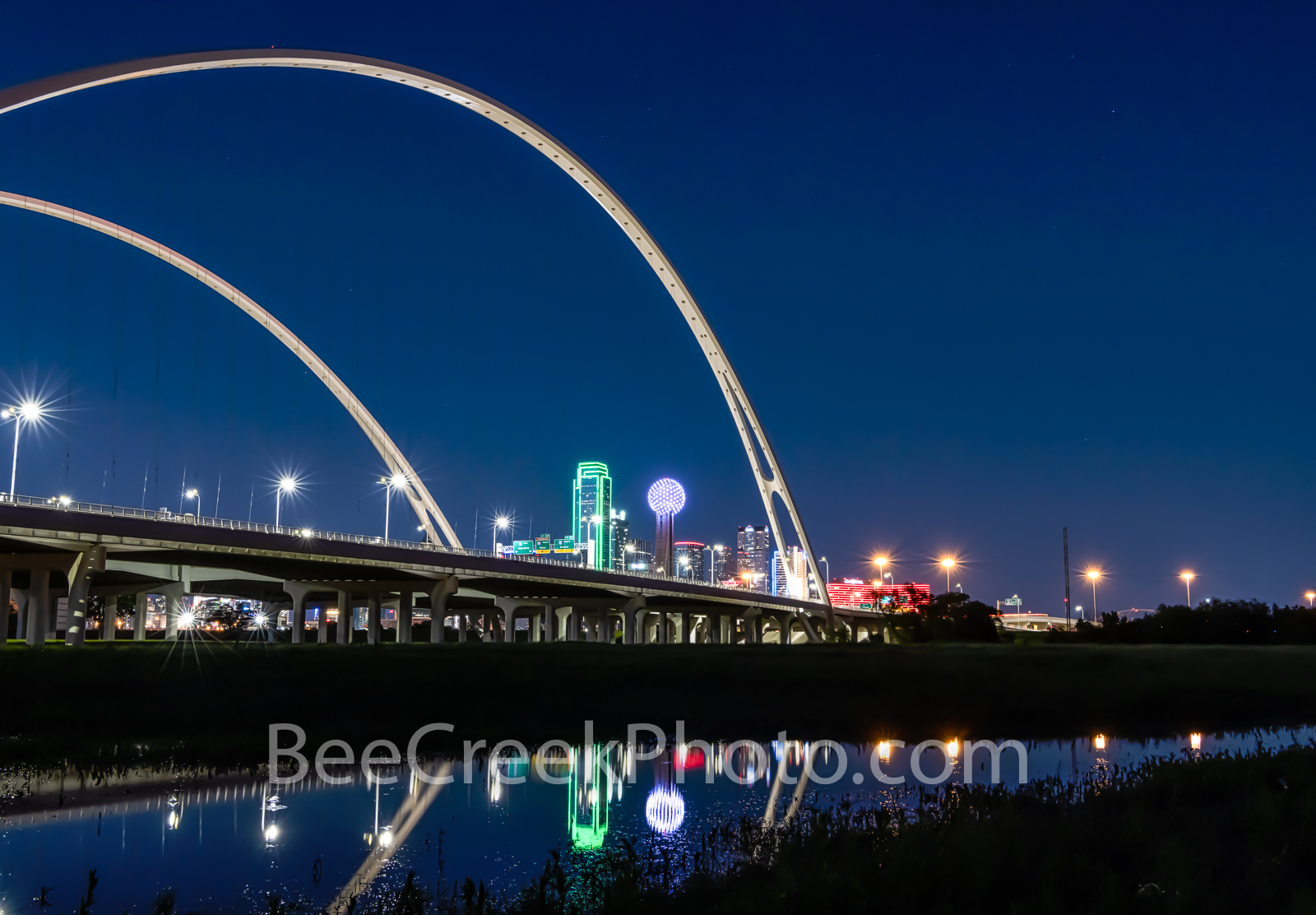Dallas McDermott Bridge Reflection 0032 - The new Margaret McDermott Bridge in downtown Dallas with skyline blue hour at night...