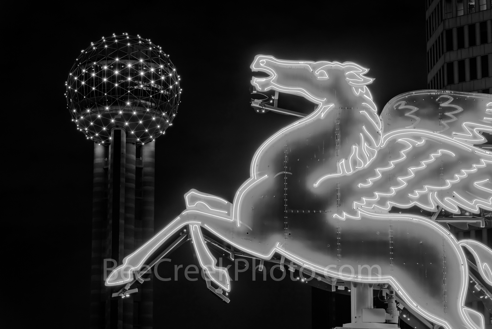 Dallas Pegasus in BW - Dallas Neon Pegasus close up with the Reunion Tower after dark in black and white as it...