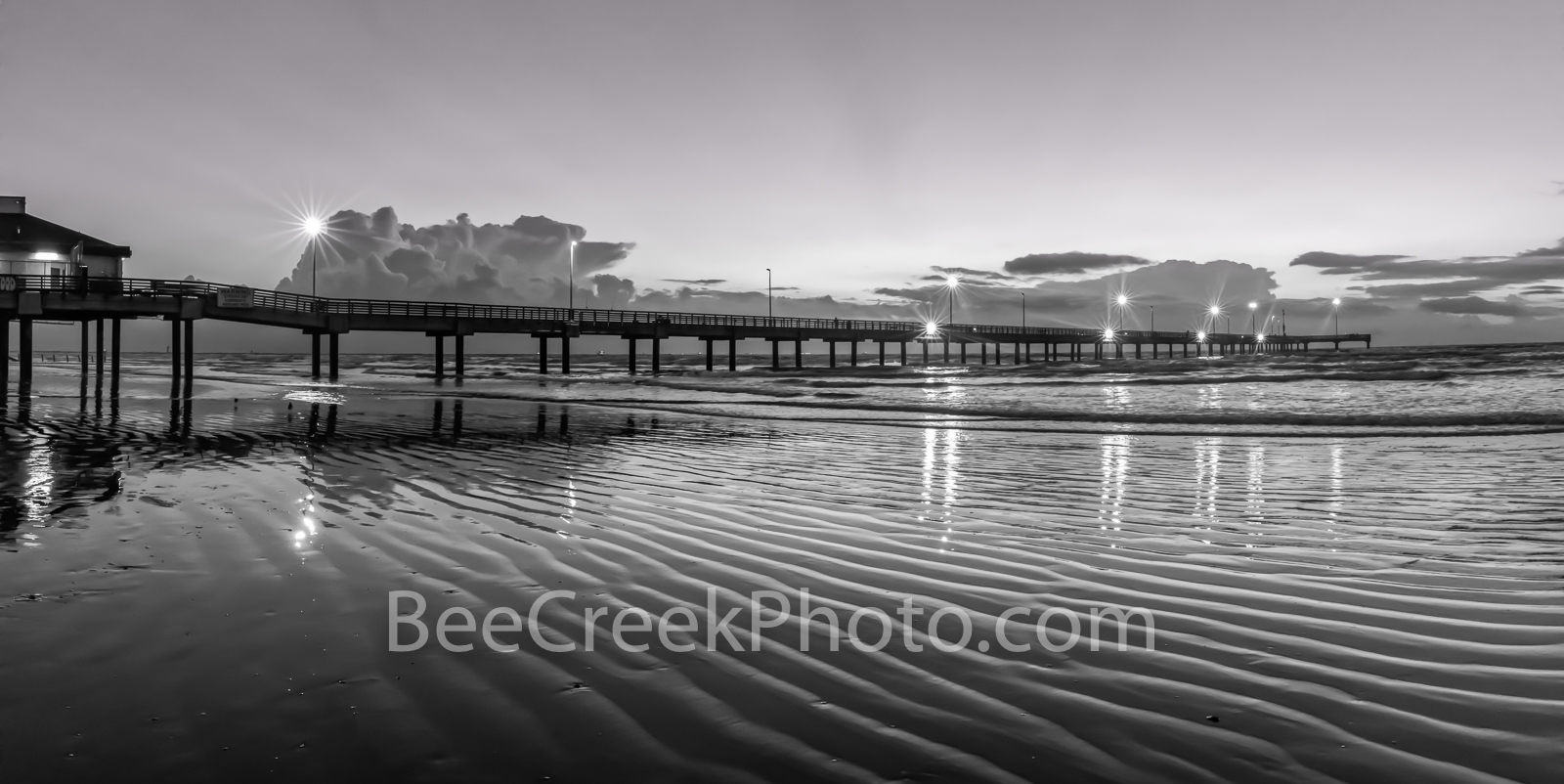 Dawn Port Aransas Pier BW Pano - This is the magic hour before the sunrise glow rays into the sky.  The caldwell pier light were...