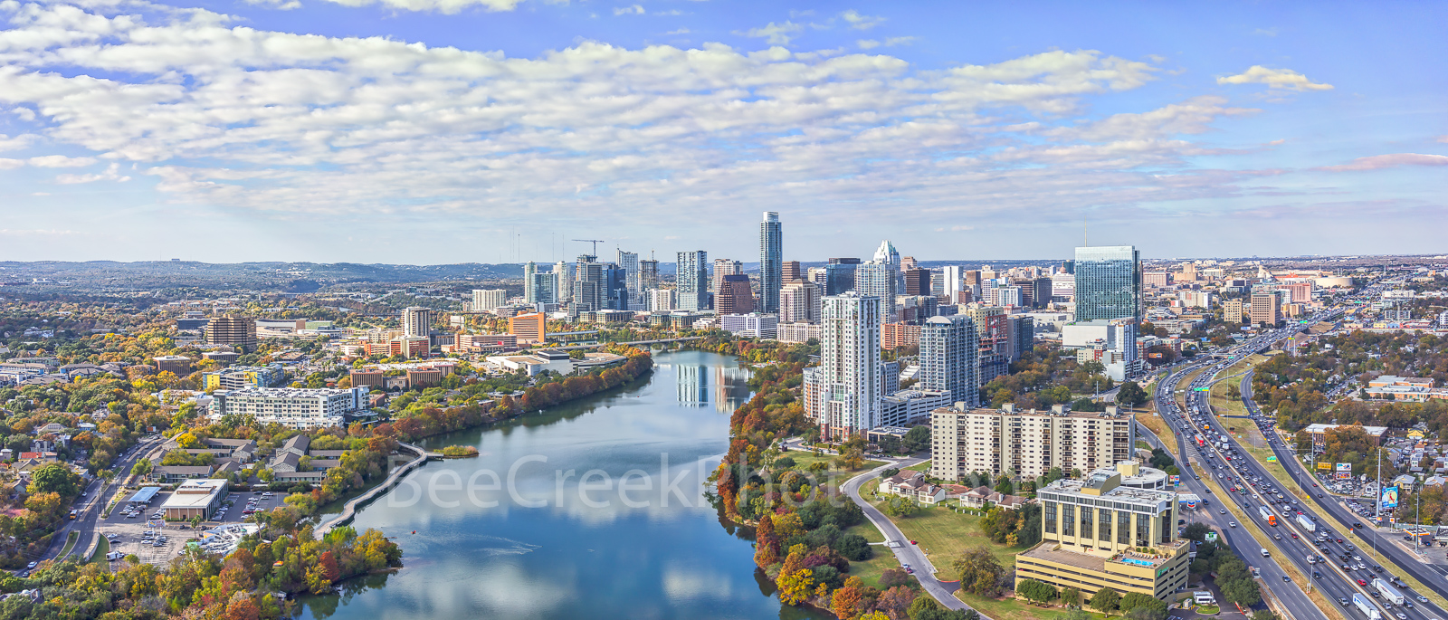 Austin skyline,  Fall Austin Skyline Pano, high rise, Lady Bird lake, city, downtown, buildings, shoreline, IH35, water, fall, aerial, drone, reflection, clouds, colorful fall trees, banks, panorama,