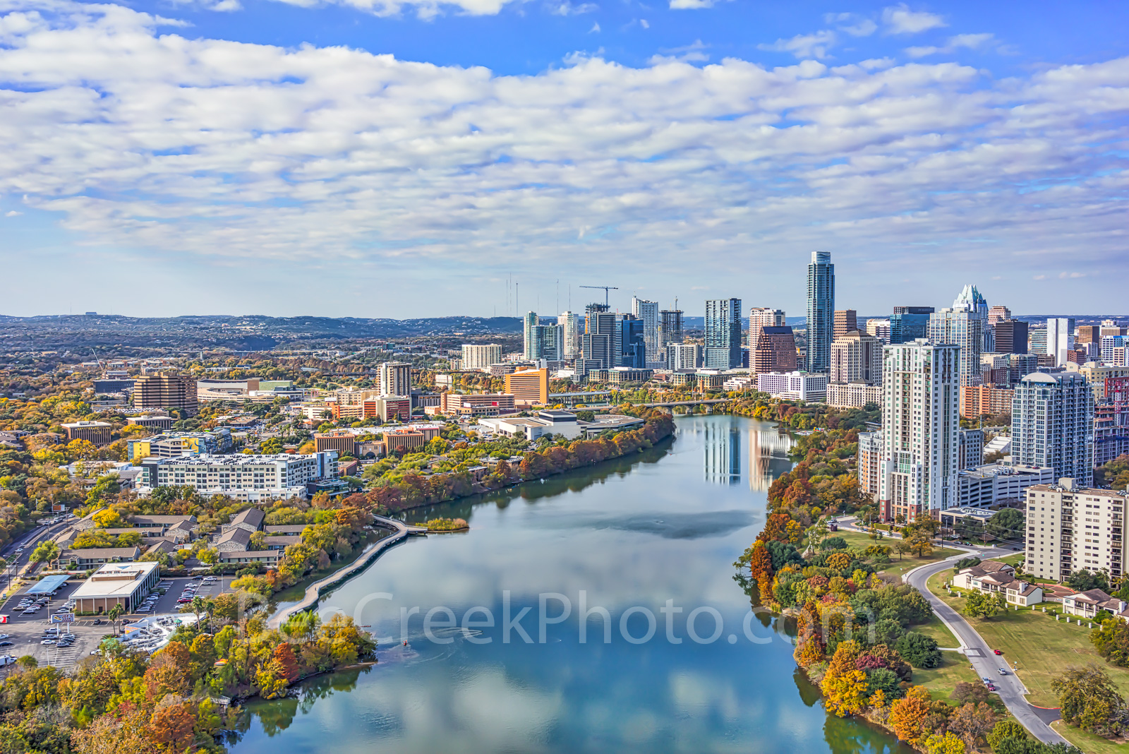 Austin skyline, Austin skyline fall view,  aerial, high rise, Lady Bird lake, city, downtown, buildings, shoreline, IH35, water, reflection, clouds, colorful fall trees, banks, panorama, Austonian,, s