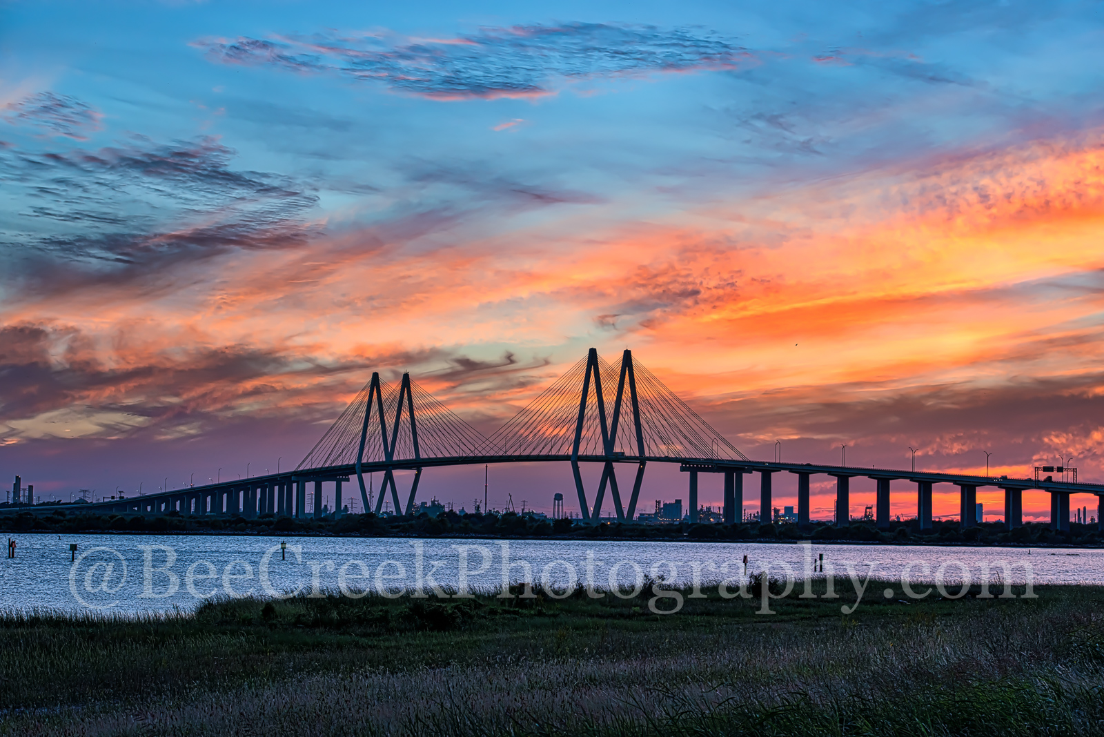 Fiery Skies Over Fred Hartman Bridge - We had a hard time picking which image to select of the Fred Hartman Bridge on the ship...
