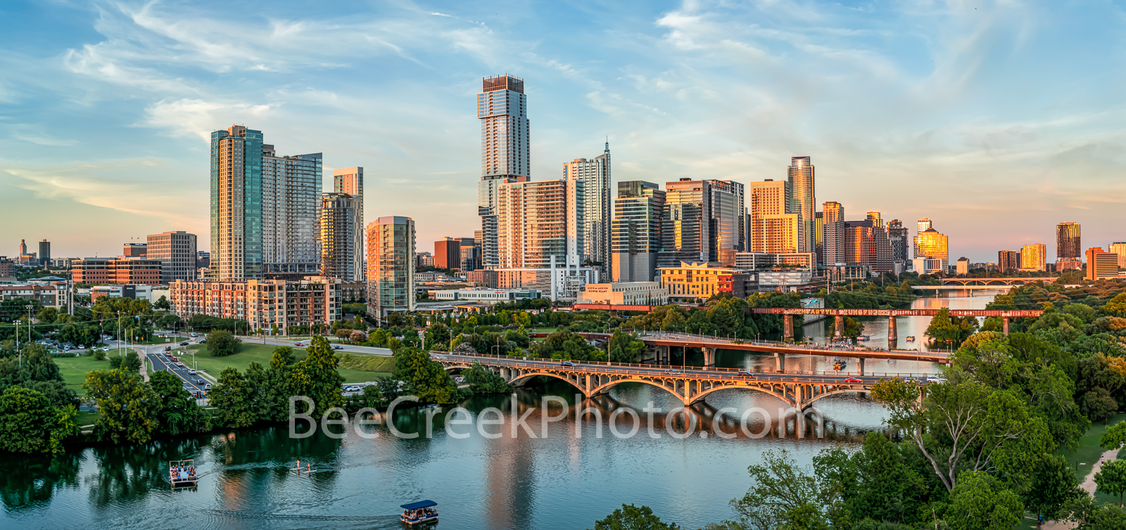 austin skyline, aerial, golden glow, pics of texas, lady bird lake, town lake, downtown, austin, lamar bridge, pfluger bridge, pedestrian bridge, ut tower, reflections, capital cruises, boat, sups, pr