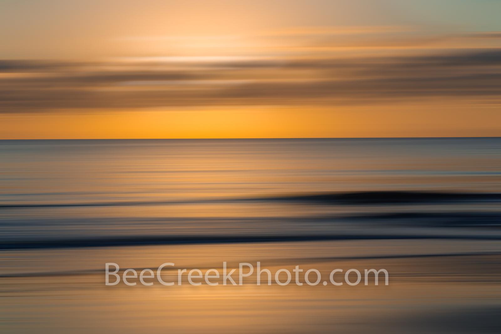 Golden Glow Sunrise Abstract - As the sunrises over the ocean waves we create this digital abstract with a surreal style. Using...