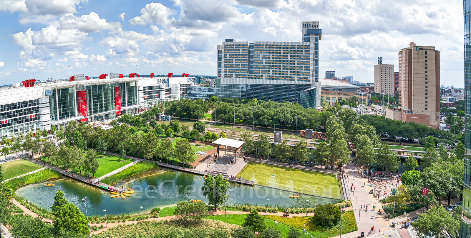 Houston, Discovery Green Park, George Brown Convention Center, water fountain, spray fountain, Kinder lake, Avenida Plaza, high rise, hotels, Hilton, downtown, city, cityscape, people,, photo