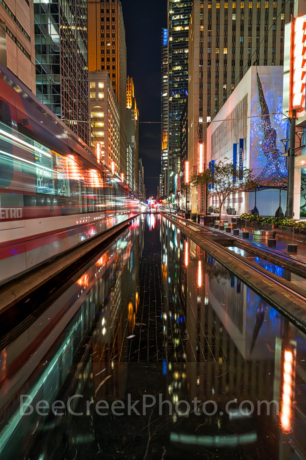 Houston, rail, mass transit, dark, night, purple lights, city, skyline, downtown, cityscape, street scene, high rise, buildings, water, purple art piece, Houston stock, , photo
