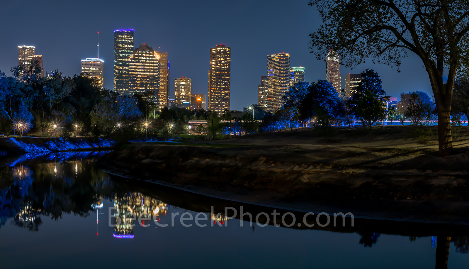 Houston skyline, cityscape, hike and bike trail, Police Memorial, dark, downtown, city, Buffalo Bayou, reflection, moon lights, faint blue glow, trees, tallest buildings, southwestern, US, Texas, pano, photo